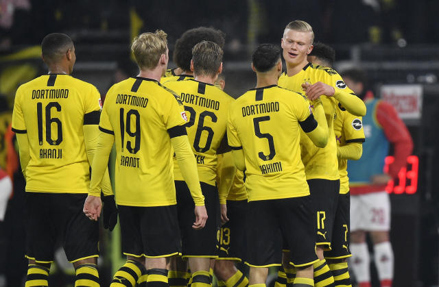 Dortmund's Erling Haaland, right, celebrates after scoring his side's 4th goal during the German Bundesliga soccer match between Borussia Dortmund and 1. FC Cologne in Dortmund, Germany, Friday, Jan. 24, 2020. (AP Photo/Martin Meissner)