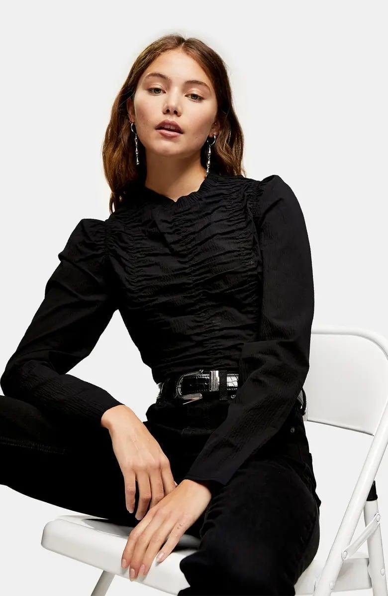 <p>Pair this <span>Topshop Ruched Long Sleeve Top</span> ($58) with your favorite jeans.</p>
