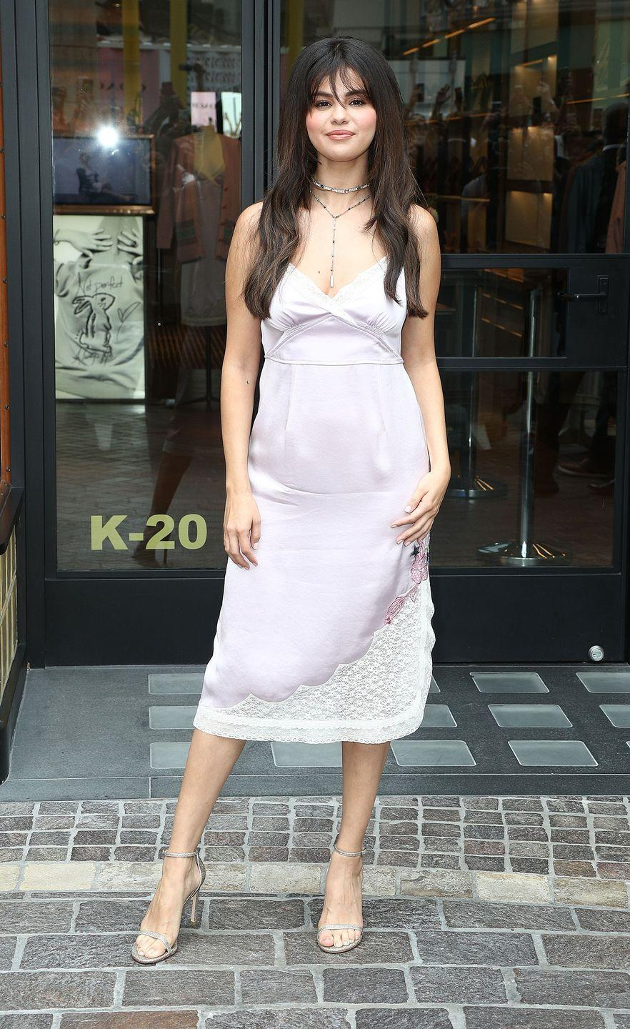 <p>Wearing a lilac slip dress to Coach's Host Meet + Greet at The Grove in Los Angeles, California.</p>