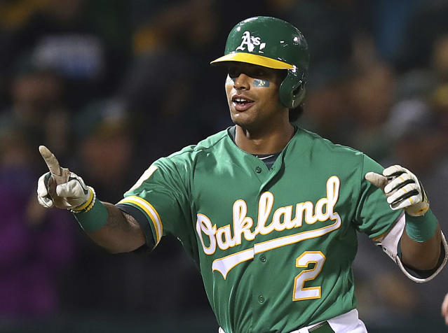 FILE - In this Sept. 21, 2018, file photo, Oakland Athletics' Khris Davis celebrates after hitting a walk-off home run in the 10th inning of a baseball game against the Minnesota Twins, in Oakland, Calif. Davis led the majors in home runs, led the Oakland Athletics back to the playoffs for the first time in four years, then received a $6 million raise this offseason for a 2019 salary of $16.5 million. (AP Photo/Ben Margot, File)
