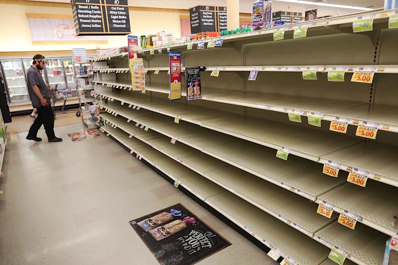 A store's bread shelves are bare as people stock up on food ahead of the arrival of Hurricane Florence on on Tuesday in Myrtle Beach, South Carolina.