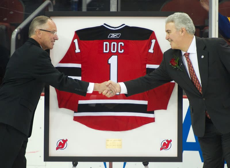 "New Jersey Devils TV announcer Mike ""Doc"" Emrick waves as he is honored by team in NHL game in Newark"