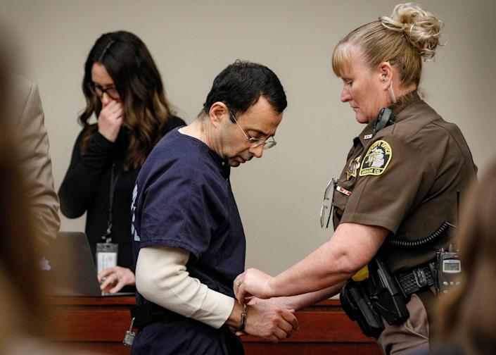 Nassar is handcuffed in the courtroom at the end of a day of testimony during his sentencing hearing. (Photo: Brendan McDermid/Reuters)