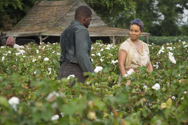 """This film image released by The Weinstein Company shows Mariah Carey as Hattie Pearl, right, in a scene from """"Lee Daniels' The Butler."""" (AP Photo/The Weinstein Company, Anne Marie Fox)"""