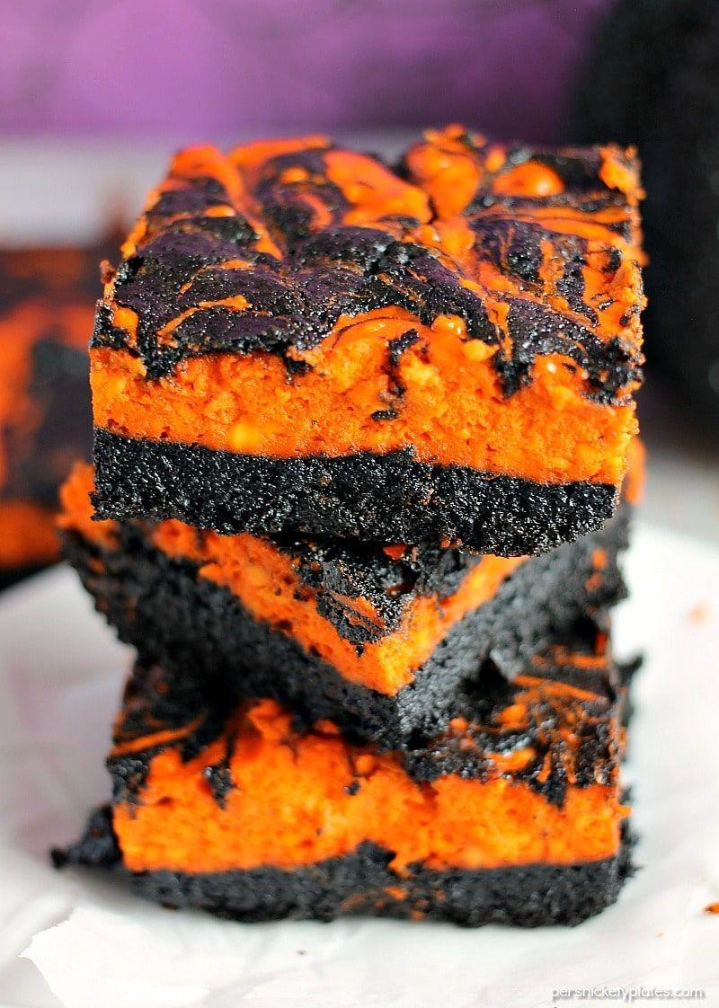 """<p>A dark chocolate brownie followed by a layer of creamy cheesecake? It's almost too good to be true. These are such a fun, colorful treat to serve at any Halloween gathering. </p><p><strong>Get the recipe at <a href=""""https://www.persnicketyplates.com/halloween-cream-cheese-swirl-brownies/"""" rel=""""nofollow noopener"""" target=""""_blank"""" data-ylk=""""slk:Persnickety Plates"""" class=""""link rapid-noclick-resp"""">Persnickety Plates</a>.</strong></p><p><strong><a class=""""link rapid-noclick-resp"""" href=""""https://go.redirectingat.com?id=74968X1596630&url=https%3A%2F%2Fwww.walmart.com%2Fip%2FThe-Pioneer-Woman-Spring-Bouquet-2-Piece-Baker-Set%2F595449072&sref=https%3A%2F%2Fwww.thepioneerwoman.com%2Ffood-cooking%2Fmeals-menus%2Fg32110899%2Fbest-halloween-desserts%2F"""" rel=""""nofollow noopener"""" target=""""_blank"""" data-ylk=""""slk:SHOP BAKING PANS"""">SHOP BAKING PANS</a><br></strong></p>"""