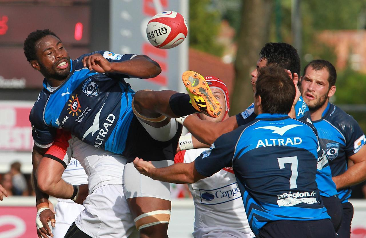 Montpellier's Fulgence Ouedraogo, left, jumps for the ball during the French Top 14 rugby union match against Biarritz at the Stade Aguilera, in Biarritz, southwestern France, Saturday Aug. 24, 2013. (AP Photo/Bob Edme)