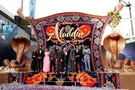 "(L-R) Nasim Pedrad, Marwan Kenzari, Naomi Scott, Mena Massoud, director Guy Ritchie, Alan Menken, Will Smith, Navid Negahban and Numan Acar attend the premiere of ""Aladdin"" at El Capitan theatre in Los Angeles, California, U.S. May 21, 2019. REUTERS/Mario Anzuoni"