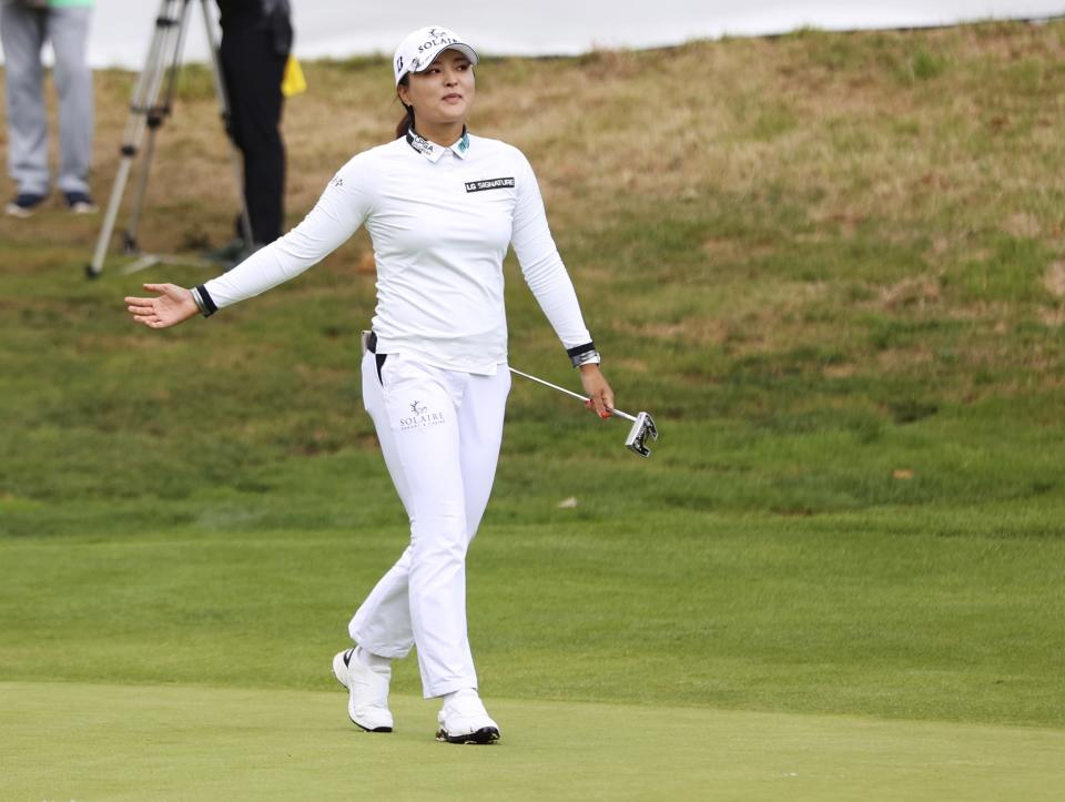 Jin Young Ko, of South Korea, reacts after making a winning putt on the 18th hole during the final round of the LPGA Cambia Portland Classic golf tournament in West Linn, Ore., Sunday, Sept. 19, 2021. (AP Photo/Steve Dipaola)