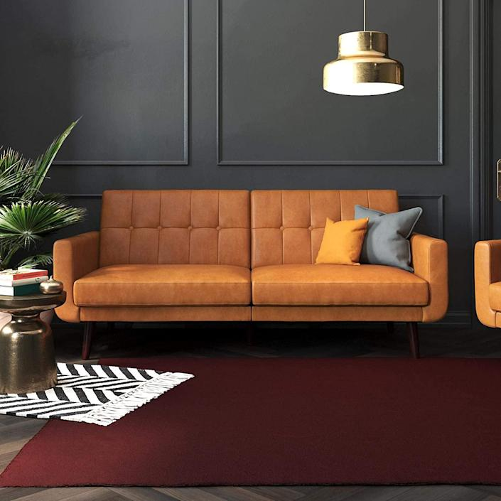 """A modern twist on a classic 1950s style, Better Homes and Gardens' faux leather Nola (a modern design available on Amazon) will become the centerpiece of just about any space. The best part? You can recline the back as much as you want—whether you're lounging during a movie or laying flat while you catch up on sleep. This piece can go from sofa to daybed to actual bed with plenty of sleeping surface. With sturdy wooden legs, the seat won't budge no matter how much you toss and turn. $394, Amazon. <a href=""""https://www.amazon.com/Better-Homes-Gardens-Camel-Leather/dp/B0857LNN4G/ref=sr_1_22?"""" rel=""""nofollow noopener"""" target=""""_blank"""" data-ylk=""""slk:Get it now!"""" class=""""link rapid-noclick-resp"""">Get it now!</a>"""