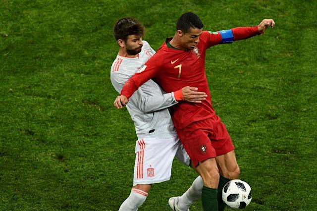 Spain's Gerard Pique challenging Portugal's Cristiano Ronaldo in the 3-3 World Cup draw (AFP Photo/Jonathan NACKSTRAND)