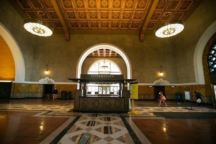 Vivid floor and wall tiles beneath the picturesque, restored ceiling in Union Station's entry vestibule.
