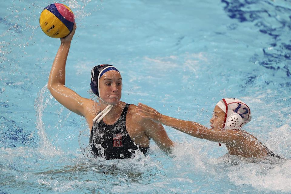 TOKYO, JAPAN - JULY 24: Kyoko Kudo of Team Japan defends against Makenzie Fischer of Team United States during the Women's Preliminary Round Group B match between Japan and the United States on day one of the Tokyo 2020 Olympic Games at Tatsumi Water Polo Centre on July 24, 2021 in Tokyo, Japan. (Photo by Clive Rose/Getty Images)