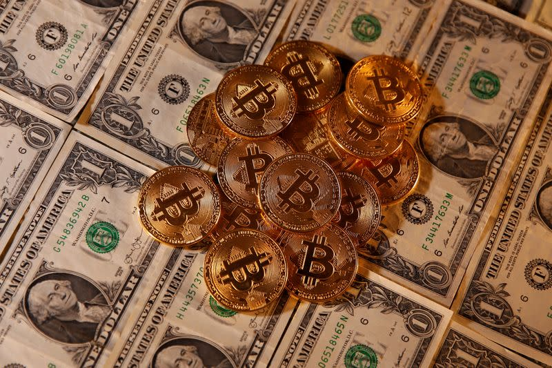Representations of virtual currency Bitcoin and U.S. dollar banknotes are seen in this picture illustration