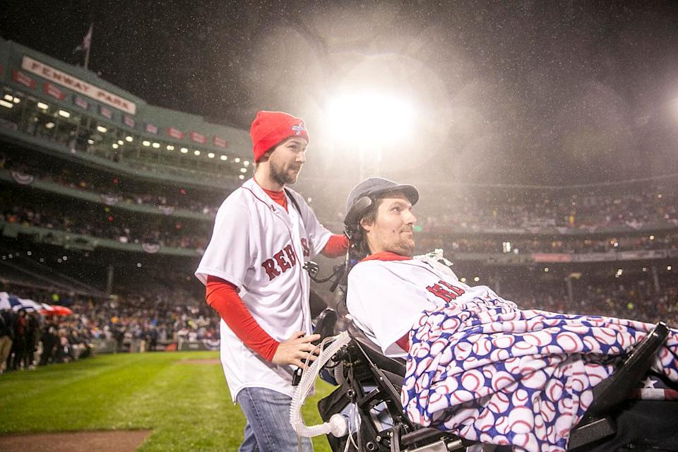 Pete Frates is introduced before a Boston Red Sox game in a packed stadium.