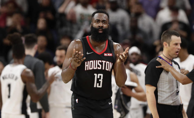"<a class=""link rapid-noclick-resp"" href=""/nba/teams/houston/"" data-ylk=""slk:Rockets"">Rockets</a> guard James Harden (13) questions his missed dunk call during the second half Tuesday night. (AP Photo/Eric Gay)"