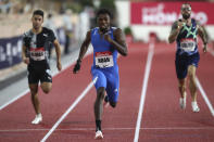 FILE - United States' Noah Lyles runs to win the the men's 1500 meter final during the Diamond League athletics meeting in Monaco, in this Friday, Aug. 14, 2020, file photo. The U.S. Olympic track trials begin Friday night, June 18, 2021, at remodeled Hayward Field. Some of the biggest events over the first week figure to be the men's 100 meters where Noah Lyles -- one of the faces of the Tokyo Games -- kicks off his bid on a potential 100-200 double. (AP Photo/Daniel Cole, Pool, File)