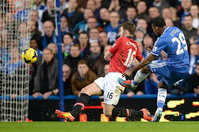 Chelsea's Samuel Eto'o, right, scores past Manchester United Michael Carick to score first goal of the game during their English Premier League soccer match at Stamford Bridge, London Sunday Jan. 19, 2014. (AP Photo/Andrew Matthews/PA)