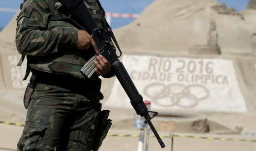 Brazilian Army Forces soldiers patrol outside the 2016 Rio Olympics Park in front of the tennis center court venue in Rio de Janeiro. Photo: Reuters