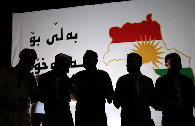 <p>Iraqi Kurdish people take part in a gathering on Sept. 20, 2017, to urge people to vote in the upcoming independence referendum in Arbil, the capital of the autonomous Kurdish region of northern Iraq. (Photo: Safin Hamed/AFP/Getty Images) </p>