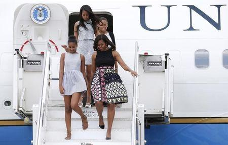 U.S. first lady Michelle Obama arrives with her daughters Sasha and Malia at Malpensa airport in Milan