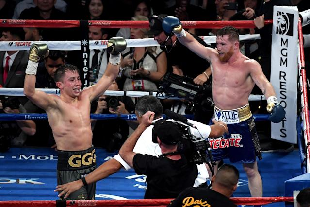 Gennady Golovkin and Canelo Alvarez both celebrate after the final round in their WBC, WBA and IBF middleweight championship bout at T-Mobile Arena on Sept. 16, 2017 in Las Vegas, Nevada. (Getty Images)