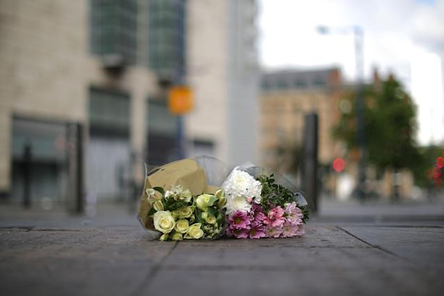 <p>The first floral tributes to the victims of the terrorist attack are placed on the empty streets on Shudehill, May 23, 2017 in Manchester, England. (Christopher Furlong/Getty Images) </p>