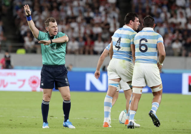 Referee Nigel Owens gestures as he awards a penalty against Argentina during the Rugby World Cup Pool C game at Tokyo Stadium between England and Argentina in Tokyo, Japan, Saturday, Oct. 5, 2019. (AP Photo/Eugene Hoshiko)