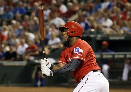 Texas Rangers' Elvis Andrus follow through on a bases clearing double to left off a pitch from Houston Astros starting pitcher Jarred Cosart in the fourth inning of a baseball game, Monday, July 7, 2014, in Arlington, Texas. The hit scored Robinson Chirinos, Rougned Odor and Shin-Soo Choo. (AP Photo/Tony Gutierrez)