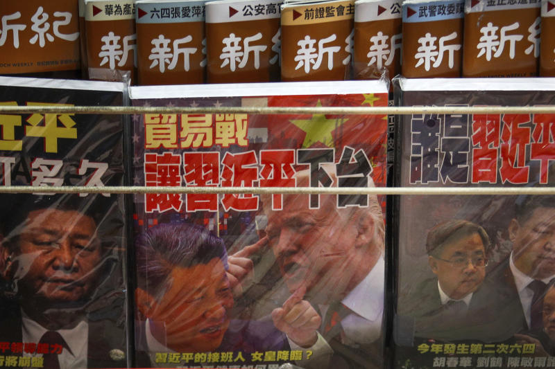 FILE - In this July 4, 2019, file photo, magazines with a front cover featuring Chinese President Xi Jinping and U.S. President Donald Trump on trade war is placed on sale at a roadside bookstand in Hong Kong. China has announced some U.S. industrial chemicals will be exempt from tariff hikes imposed in a trade war with Washington but maintained penalties on soybeans, pork and other farm goods. The Ministry of Finance's announcement Wednesday, Sept. 11, 2019 came ahead of October talks aimed at ending the fight over trade and technology that threatens global economic growth. (AP Photo/Andy Wong, File)