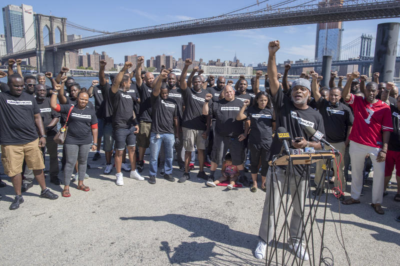 Retired New York City Police Deputy Inspector and author Corey Pegues is surrounded by members of law enforcement as he speaks during a rally to show support for Colin Kaepernick on Saturday. (AP)