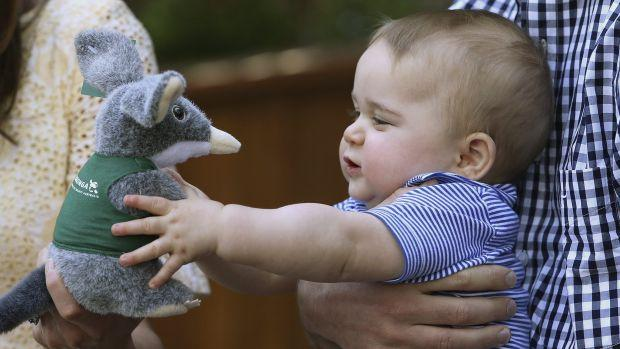Britain's Prince George holds a toy Bilby during a visit to a zoo in Australia.
