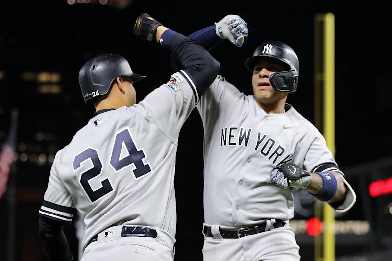 MINNEAPOLIS, MINNESOTA - OCTOBER 07: Gleyber Torres #25 of the New York Yankees celebrates with Gary Sanchez #24 after his solo home run off Jake Odorizzi #12 of the Minnesota Twins in the second inning in game three of the American League Division Series at Target Field on October 07, 2019 in Minneapolis, Minnesota. (Photo by Elsa/Getty Images)