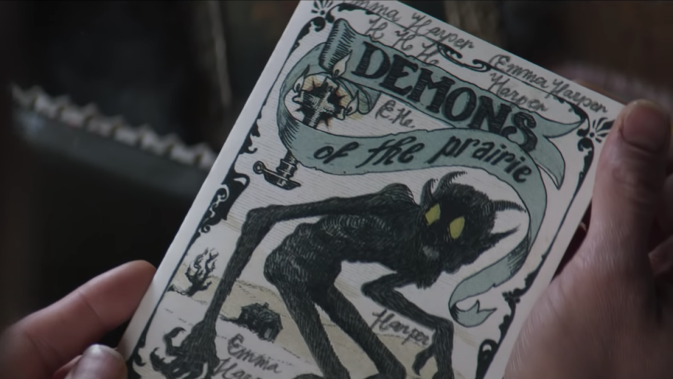 An image of a pamphlet with a demon on the cover in the movie The Wind