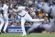 San Diego Padres third baseman Manny Machado attempts to throw out Colorado Rockies' Brendan Rodgers during the first inning of a baseball game Thursday, July 29, 2021, in San Diego. Rodgers was safe. (AP Photo/Derrick Tuskan)