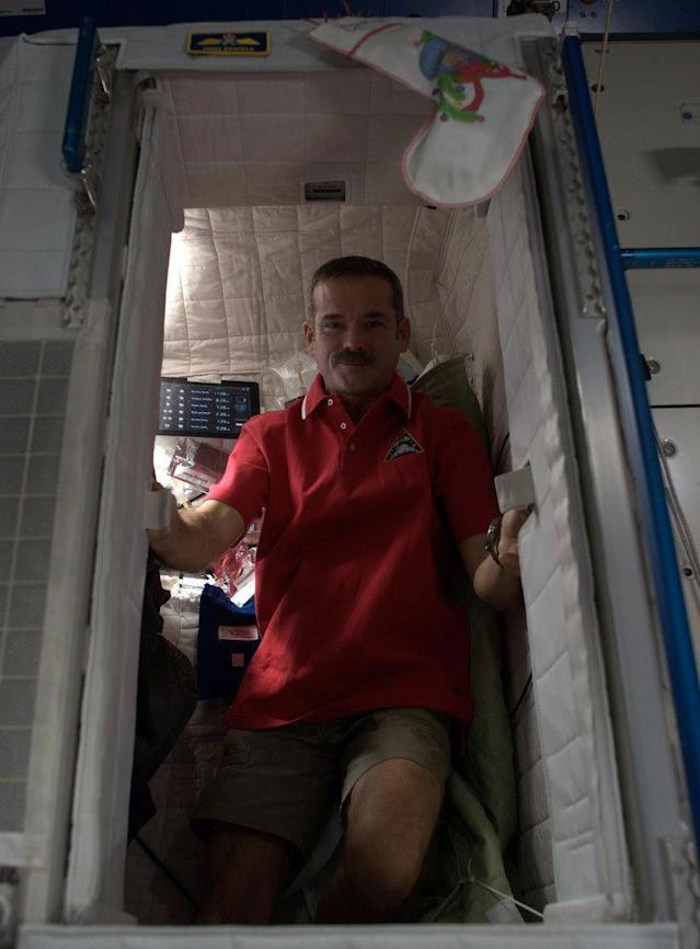 Inside my Sleep Pod - it serves as my bedroom, recording studio, and twitter zone while on the Space Station.