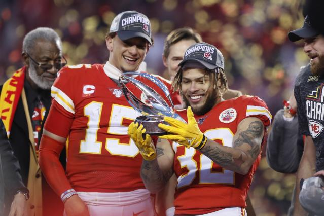 Kansas City Chiefs' Tyrann Mathieu and Patrick Mahomes (15) hold up the Lamar Hunt Trophy after the NFL AFC Championship football game against the Tennessee Titans Sunday, Jan. 19, 2020, in Kansas City, MO. The Chiefs won 35-24 to advance to Super Bowl 54. (AP Photo/Charlie Neibergall)