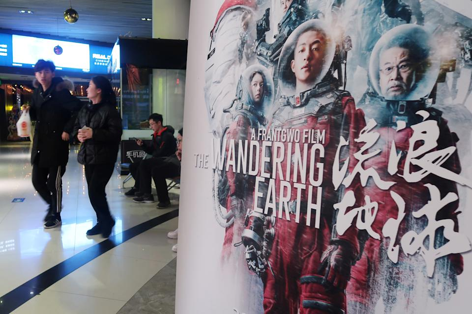 "A poster of Chinese film ""The Wandering Earth"" is pictured at a cinema in Zhengzhou, Henan province, China February 11, 2019. Picture taken February 11, 2019. REUTERS/Stringer ATTENTION EDITORS - THIS IMAGE WAS PROVIDED BY A THIRD PARTY. CHINA OUT."