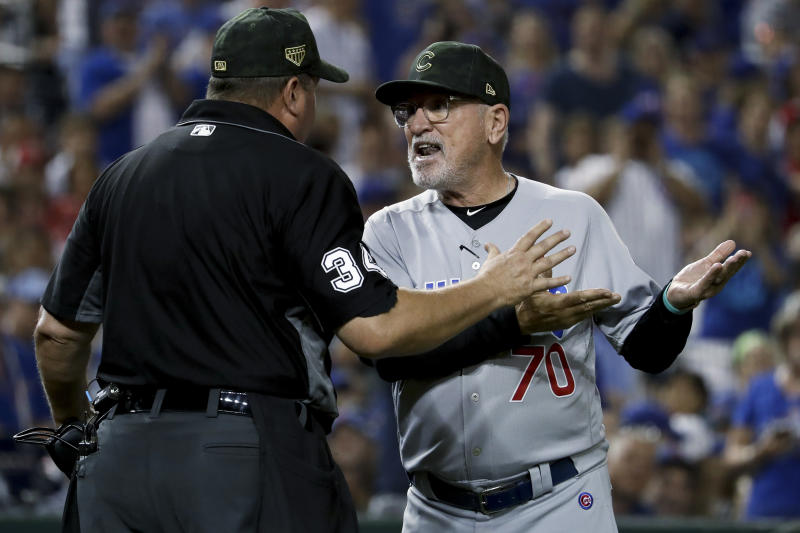 Chicago Cubs manager Joe Maddon argues with umpire Sam Holbrook (34) over the delivery of Washington Nationals relief pitcher Sean Doolittle during the ninth inning of a baseball game Saturday, May 18, 2019, in Washington. Maddon thought Doolittle was using an illegal delivery. Maddon believed the left-handed Doolittle was tapping his right toe on the ground before coming to the plate. The Nationals won 5-2. (AP Photo/Andrew Harnik)