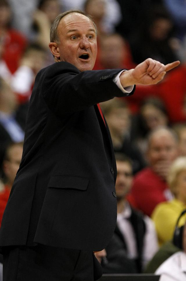 Ohio State coach Thad Matta directs his team during the second half of an NCAA college basketball game against Delaware in Columbus, Ohio, Wednesday, Dec. 18, 2013. Ohio State won 76-64. ( AP Photo/Paul Vernon)