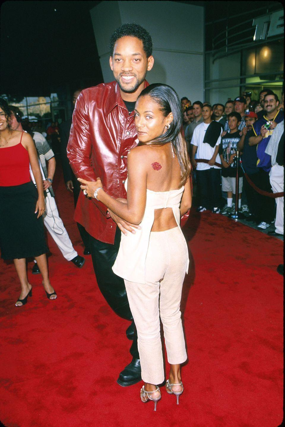 <p>At the Oscar De La Hoya Fight the World Welterweight Championship, Will was a bad boy in a red leather shirt, while Jada opted for a lower-back cut-out and a rhinestone decal.</p>
