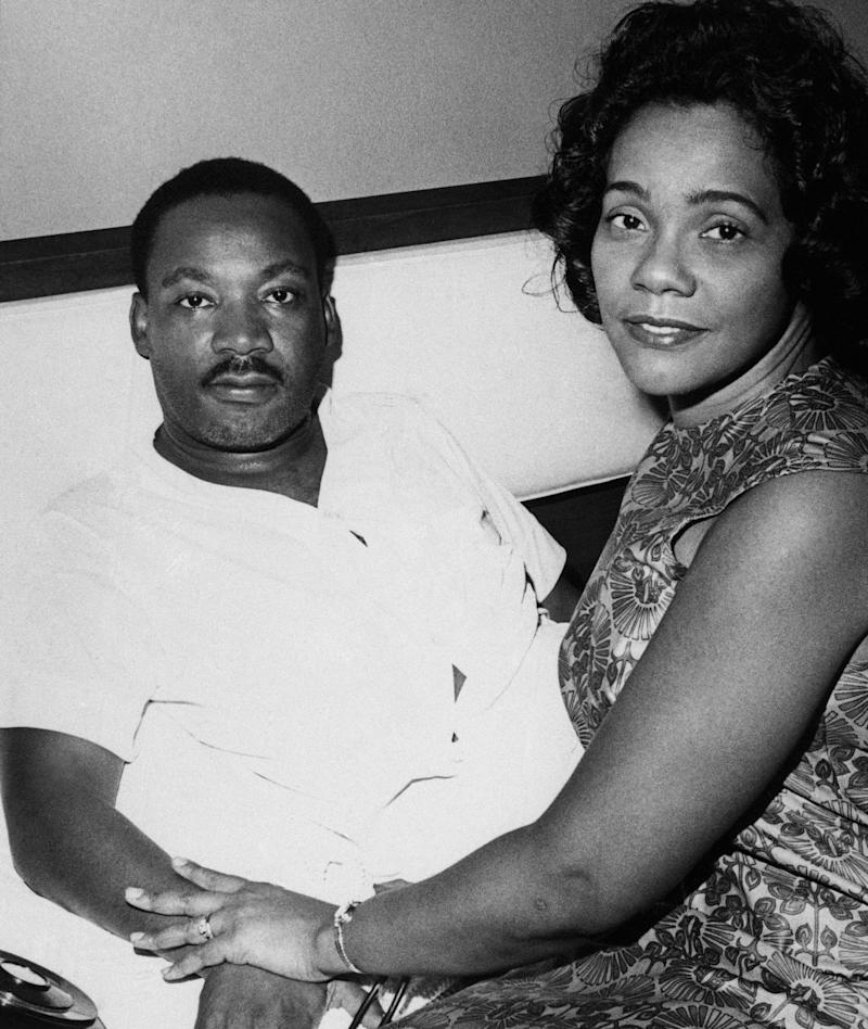 Dr. Martin Luther King and his wife Coretta discuss his condition with newsmen at his downtown hotel room in Jackson, Mississippi on August 12, 1966. King, who was there for the annual meeting of his Southern Christian Leadership Conference, missed key activities because of a virus ailment. (AP Photo)