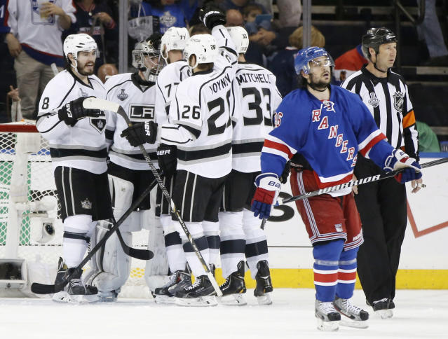 New York Rangers right wing Mats Zuccarello (36) skates off the ice as the Los Angeles Kings celebrate their 3-0 win in Game 3 of the NHL hockey Stanley Cup Final, Monday, June 9, 2014, in New York. (AP Photo/Kathy Willens)