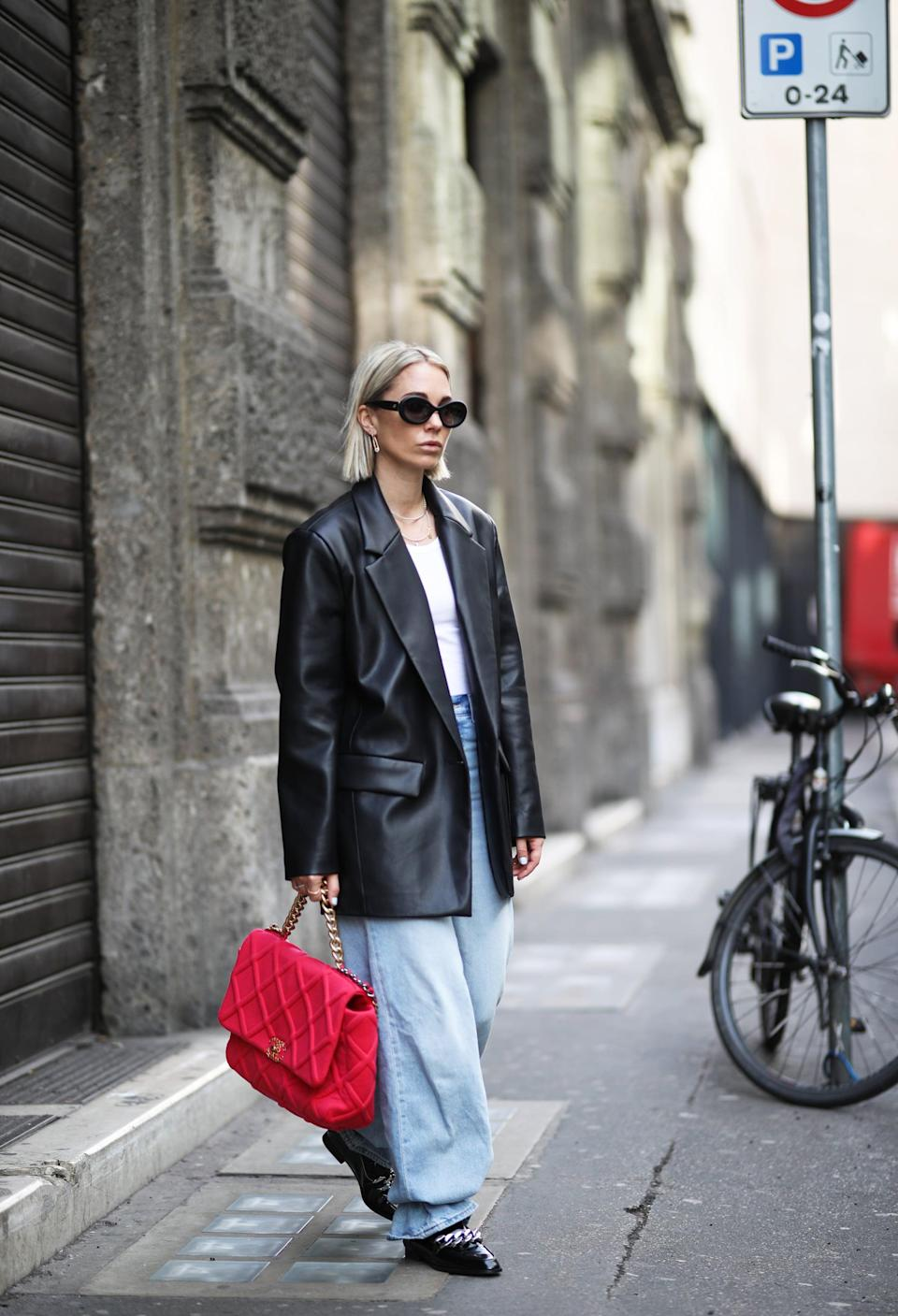 <p>A superslouchy pair of jeans looks smart with a leather blazer, sleek flats, and an oversize bag. </p>