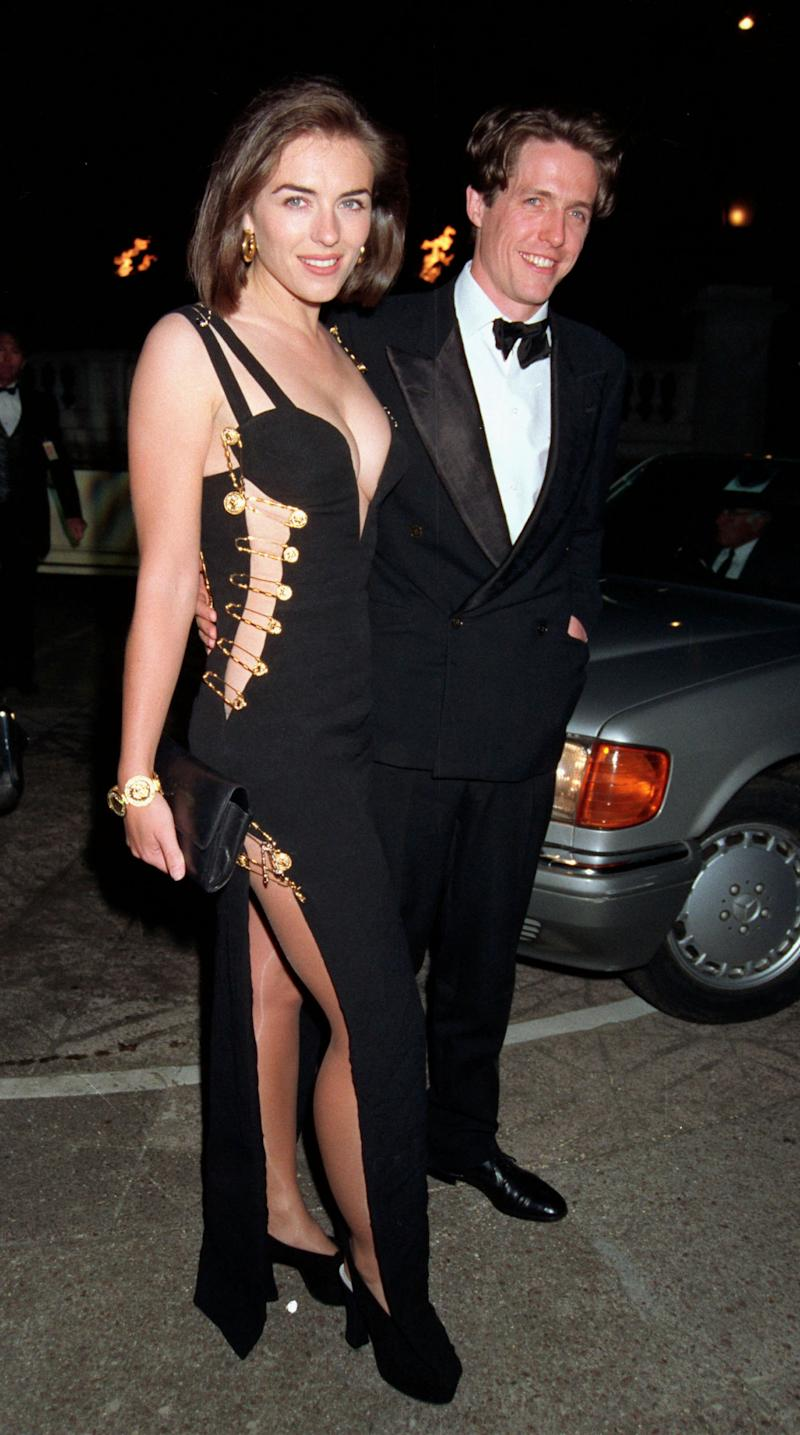 "Elizabeth Hurley wearing famous Versace dress that she wore in 1994 to the film premiere of ""Four Weddings and A Funeral"" with Hugh Grant"