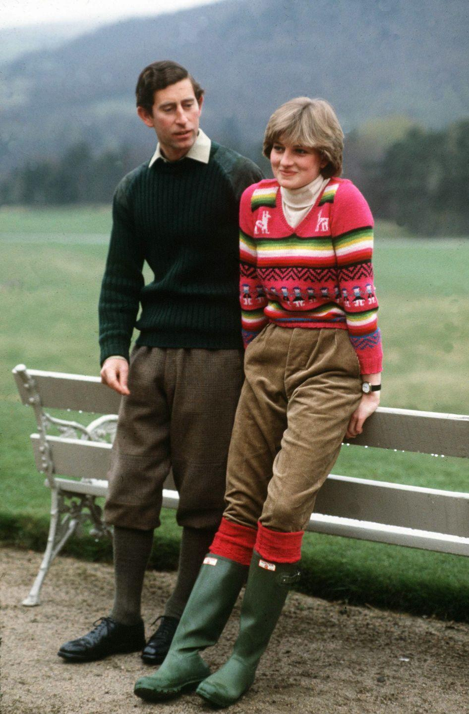 """<p>In one of her <a href=""""https://www.townandcountrymag.com/society/tradition/g34374429/princess-diana-statement-sweater-photos/"""" rel=""""nofollow noopener"""" target=""""_blank"""" data-ylk=""""slk:iconic sweater moments"""" class=""""link rapid-noclick-resp"""">iconic sweater moments</a>, Princess Diana wore this fair isle-esque pink sweater at Balmoral in 1981. </p>"""