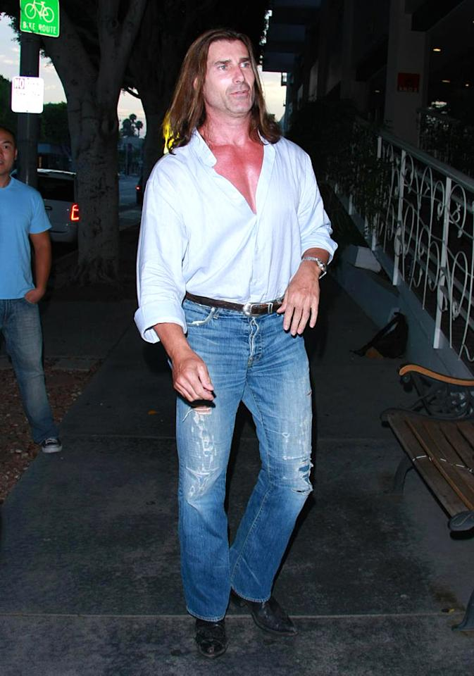 "Fabio, the long-haired lothario best known for his romance novel covers, clearly hasn't changed his look since his ""I Can't Believe It's Not Butter"" days back in the early '90s. Anthony/ PacificCoastNews.com - July 13, 2008"