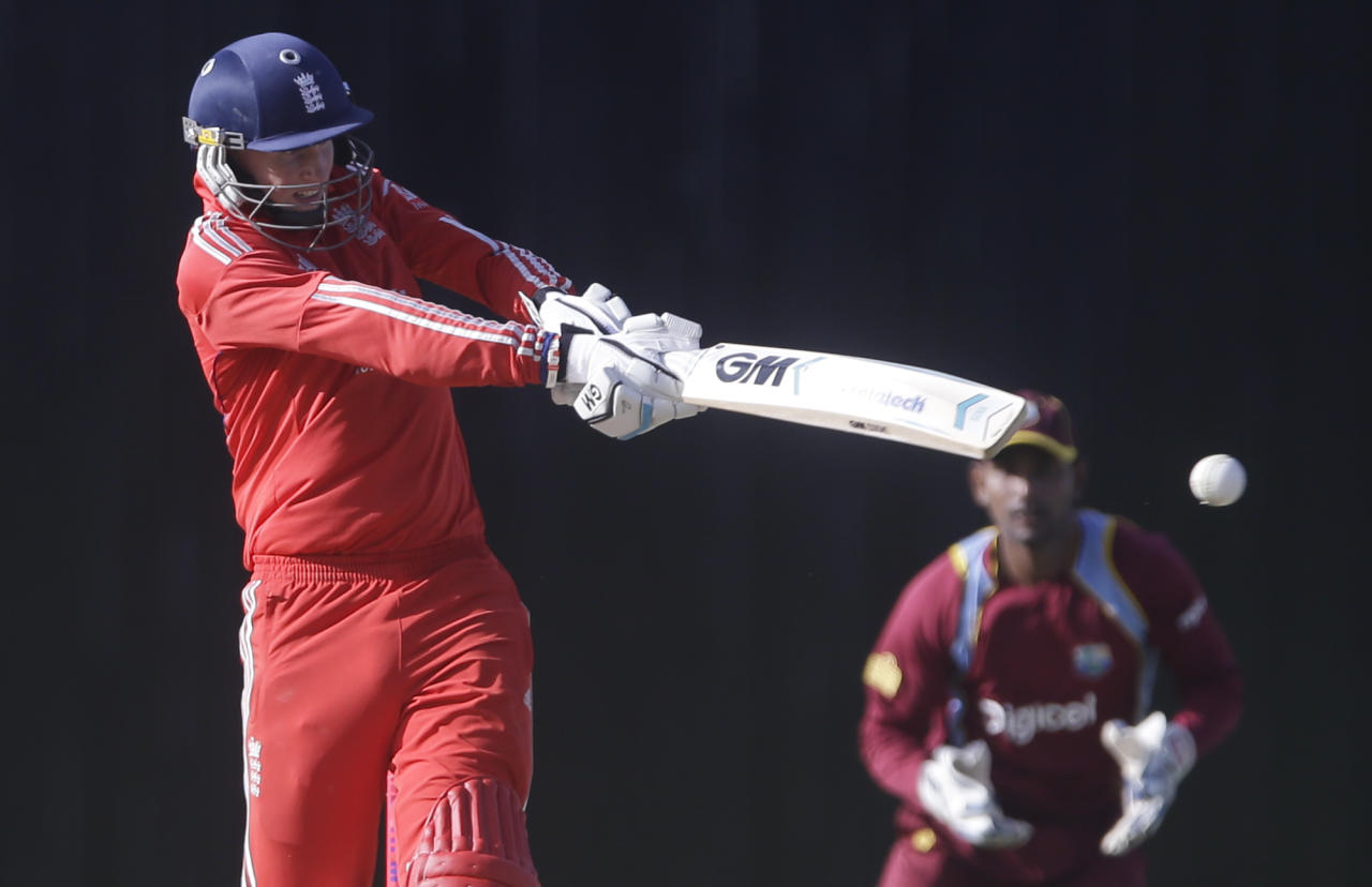 England's Joe Root plays a shot during a one-day international cricket match against West Indies at the Sir Vivian Richards Cricket Ground in St. John's, Antigua, Friday, Feb. 28, 2014. (AP Photo/Ricardo Mazalan)