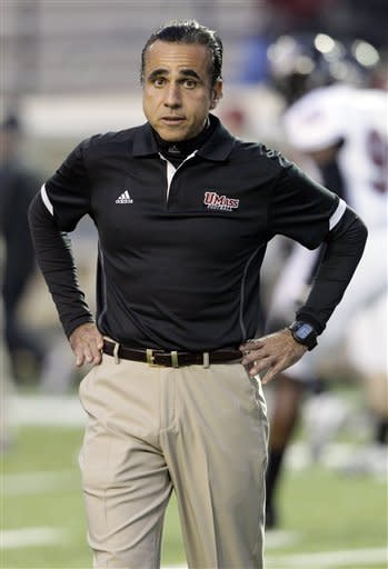 Massachusetts coach Charley Molnar watches his players before an NCAA college football game against Vanderbilt on Saturday, Oct. 27, 2012, in Nashville, Tenn. (AP Photo/Wade Payne)