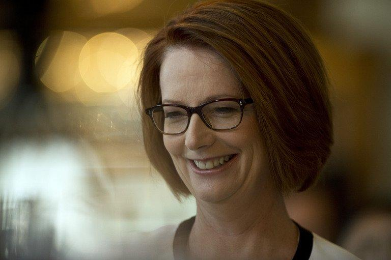 Australia's Prime Minister Julia Gillard smiles prior to giving an address to the Foreign Corresspondents Association in Sydney on April 4, 2013. Gillard, who is tipped to lose her bid for a third Labor government term in September, said unusually low tax revenue, which wasn't forecast even a few months ago would require serious belt-tightening in the next budget