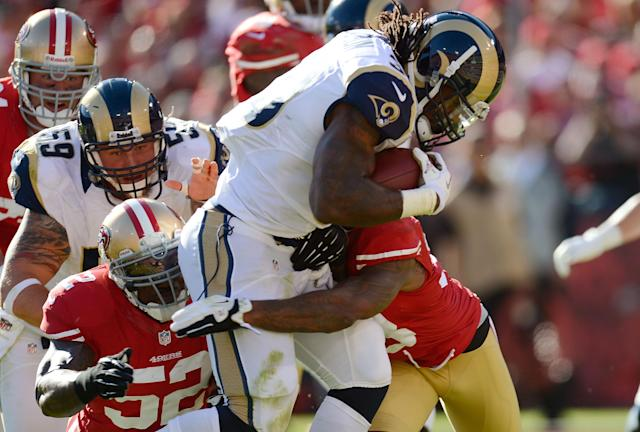 SAN FRANCISCO, CA - NOVEMBER 11: Steven Jackson #39 of the St. Louis Rams drags Dashon Goldson #38 and Patrick Willis #52 of the San Francisco 49ers into the endzone for a seven yard touchdown run in the first quarter of their NFL football game at Candlestick Park on November 11, 2012 in San Francisco, California. (Photo by Thearon W. Henderson/Getty Images)